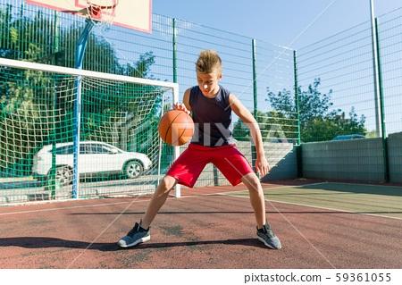 Teenager boy street basketball player on the city basketball court 59361055