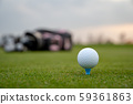A golf player prepares the ball to be fired at the golf course 59361863