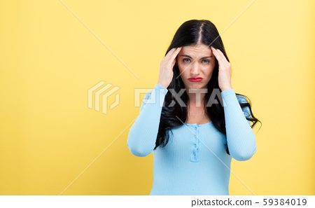 Young woman suffering from headache 59384019