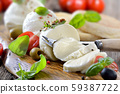 Italian mozzarella cheese snack with cherry tomatoes, basil and olives served with toast bread 59387722
