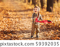 little boy plays with plane 59392035