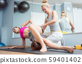 Woman stretching and relaxing in physical therapy exercise 59401402