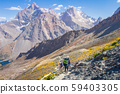 Amazing mountain landscape with tourists on hiking 59403305