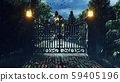 An old abandoned horror house in the forest at night with ghosts and mystical fog. The glowing 59405196
