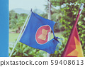 The old Association of South East Asian Nations flag with a big hole decorative on the building 59408613