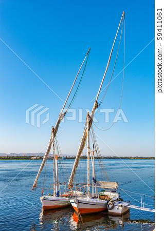 Two moored sailboats 59411061