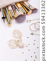 Set of brushes and cosmetic products in a cosmetic bag on a white background 59413362