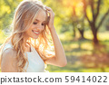 Young woman blonde hair summer style concept 59414022