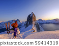 Skitouring man standing at the ridge in front of the iconic Segla mountain, view of the ocean fjords 59414319