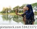 Teenager muslim selfie 59423372