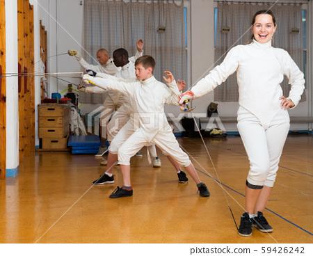 Woman in fencing uniform in gym 59426242