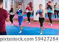 Group positive women are boxing with coach 59427264