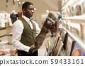 Man standing near souvenir shop 59433161
