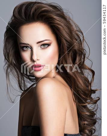 Beautiful woman with long bown hair 59434117