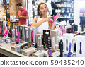 Smiling girl buyer choosing color sexy toys 59435240