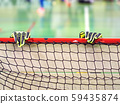 Goalkeeper gloves on beam of floorball goal gate 59435874