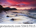 Sunset on the rocky shore of tropical sea 59437015
