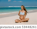 Pregnant woman expecting baby at tropical beach 59448261