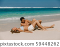 Young pregnant woman with husband at paradise beach. Happy couple at tropical island 59448262