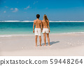 Young pregnant woman with husband at paradise beach. Happy couple at tropical island 59448264