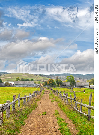 mountains with wooden fence 59454993