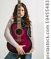 Redhead woman holding acoustic guitar 59455483
