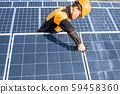 Workman on the solar station 59458360