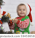 Lovely greeting card with baby elf near Christmas tree 59459658