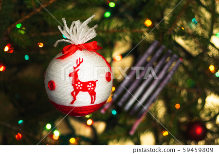 Festive decorations hanging from the Christmas 59459809