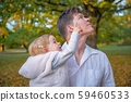 Happy dad with daughter enjoying autumn in park at beautiful weather 59460533