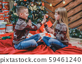 Warm shot of happy friends playing clapping game, enjoying Christmas atmosphere. 59461240