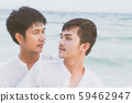 Homosexual portrait young asian couple standing hug and look together on beach 59462947