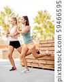 women training and doing single leg squats 59466595