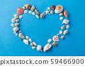 sea shells in shape of heart on blue background 59466900