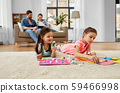 happy sisters doing arts and crafts at home 59466998