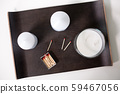 fragrance candles and matches on tray on table 59467056