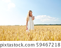 smiling young girl on cereal field in summer 59467218
