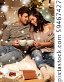 happy couple drinking hot chocolate on christmas 59467427