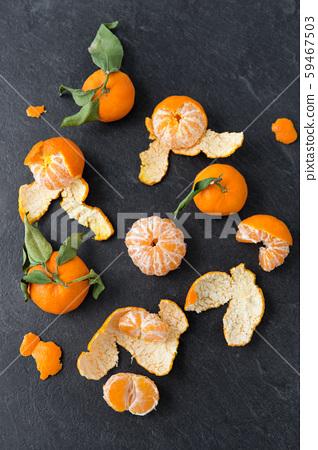 close up of peeled mandarins on slate table top 59467503