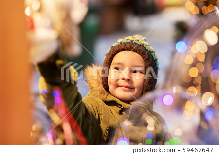 happy little boy at christmas market in winter 59467647
