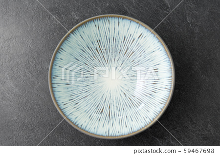 close up of blue ceramic plate on slate background 59467698