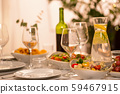 table served with plates, wine glasses and food 59467915