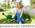 woman calling on smartphone at summer garden 59468030