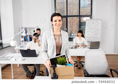 happy businesswoman with personal stuff at office 59468032