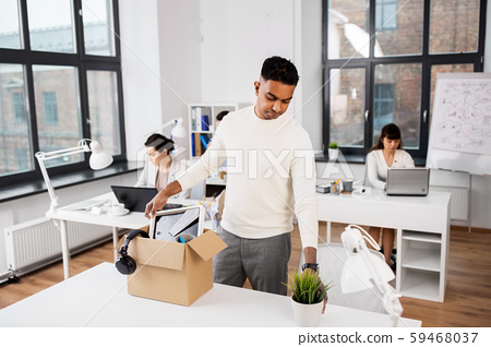 sad fired office worker packing personal stuff 59468037