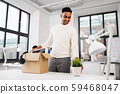 happy male office worker with personal stuff 59468047