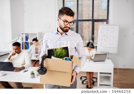 sad fired male office worker with personal stuff 59468258