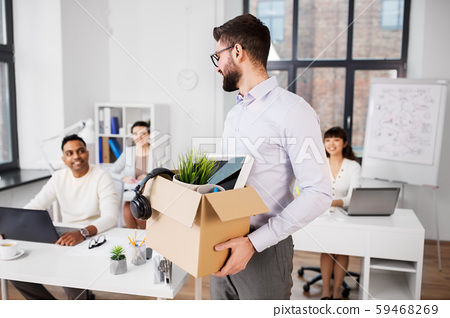 happy male office worker with personal stuff 59468269