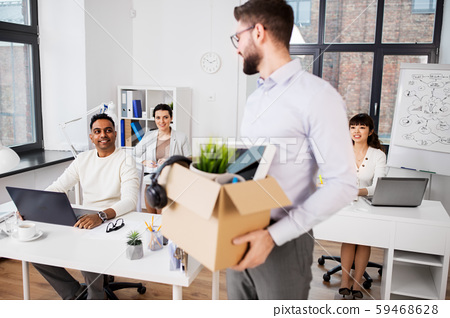 happy male office worker with personal stuff 59468628