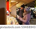 happy senior couple hugging at christmas market 59468943